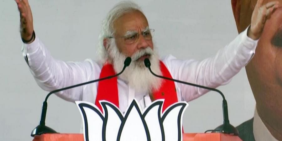 Prime Minister Narendra Modi addresses an election rally, in Bankura on Sunday.