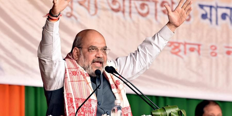 Union Home Minister Amit Shah speaks during an election campaign rally, ahead of Assam assembly polls, at Nazira in Sivasagar district on Sunday