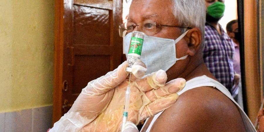 A medic prepares to administer COVID-19 vaccine to senior citizen in Agartala, Friday,