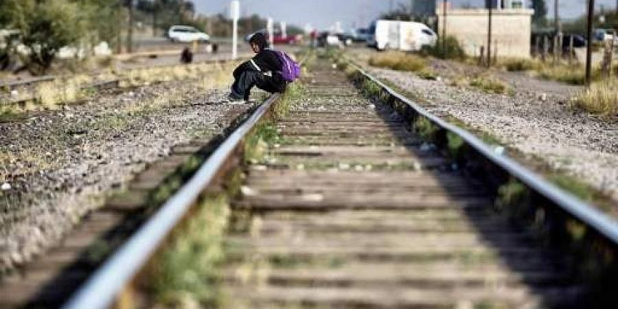 A migrant rests on the train tracks in the community of Caborca in Sonora state, Mexico, on January 12, 2017. Hundreds of Central American and Mexican migrants attempt to cross the US border daily.(Photo | AFP)