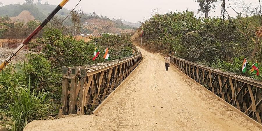 A person is seen walking towards India from the Myanmar side along the under-construction bridge. (Photo | Express)