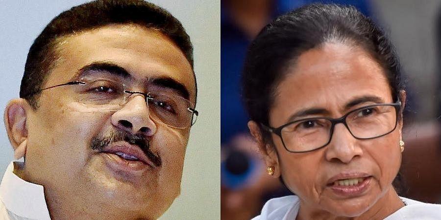 BJP leader Suvendu Adhikari (L) and West Bengal CM Mamata Banerjee