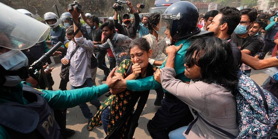 Bangladeshi students clash with police during a protest in Dhaka, Bangladesh.