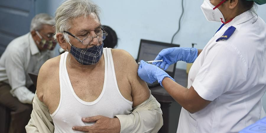 A medic administers the first dose of COVID-19 vaccine to a senior citizen during the second phase of a countrywide inoculation drive at Rajawad Municipal Hospital in Mumbai Wednesday