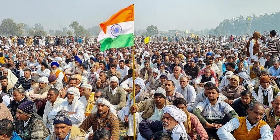 Farmers during 'Kisan Mahapanchayat' against the new farm laws in Jind district.