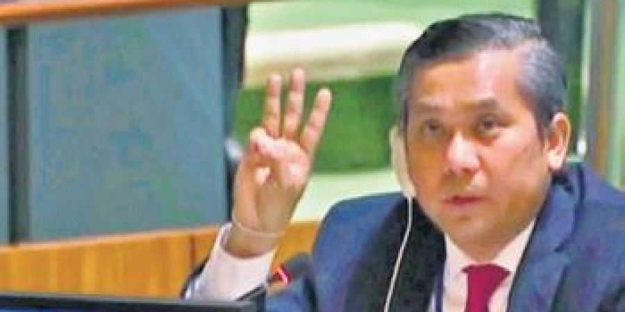 Myanmar envoy to the UN flashes the three-fingered salute—a gesture supporting anti-coup protests. (File Photo | AFP)