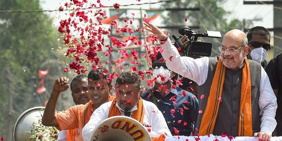 Union Home Minister Amit Shah during an election campaign roadshow in support of BJP candidate Suvendu Adhikari from Nandigram constituency
