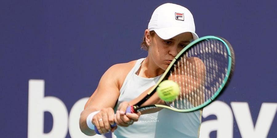 Ashleigh Barty of Australia, returns to Victoria Azarenka of Belarus, during the Miami Open tennis tournament