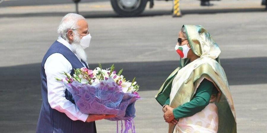 PM Narendra Modi arrives in Bangladesh, where he was welcomed by PMSheikh Hasina.