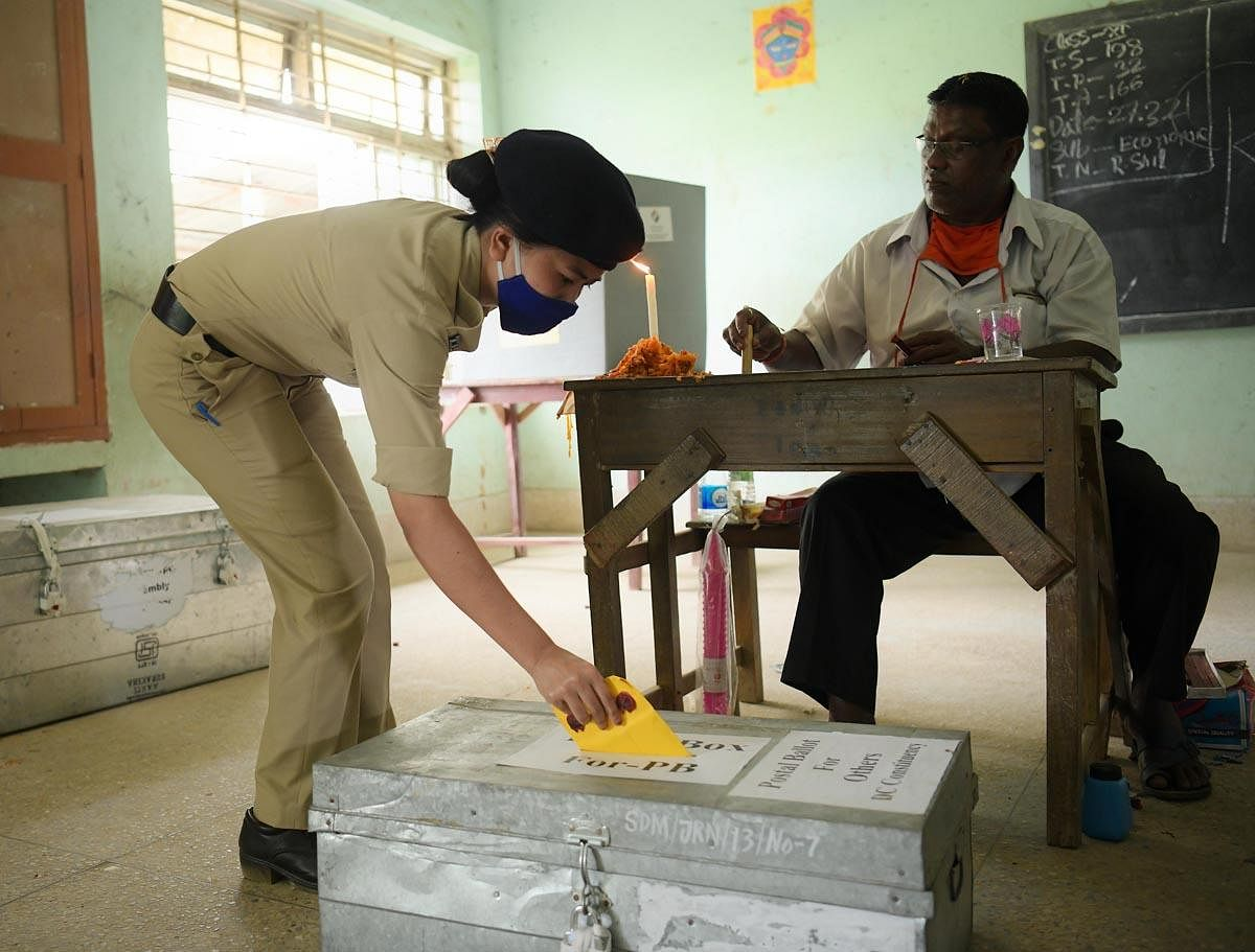 The female security personal casting vote during a postal ballot for government personnel, recruited for election duty in Jirania, 17 km far fromAgartala. (Photo | Abhisek Saha)