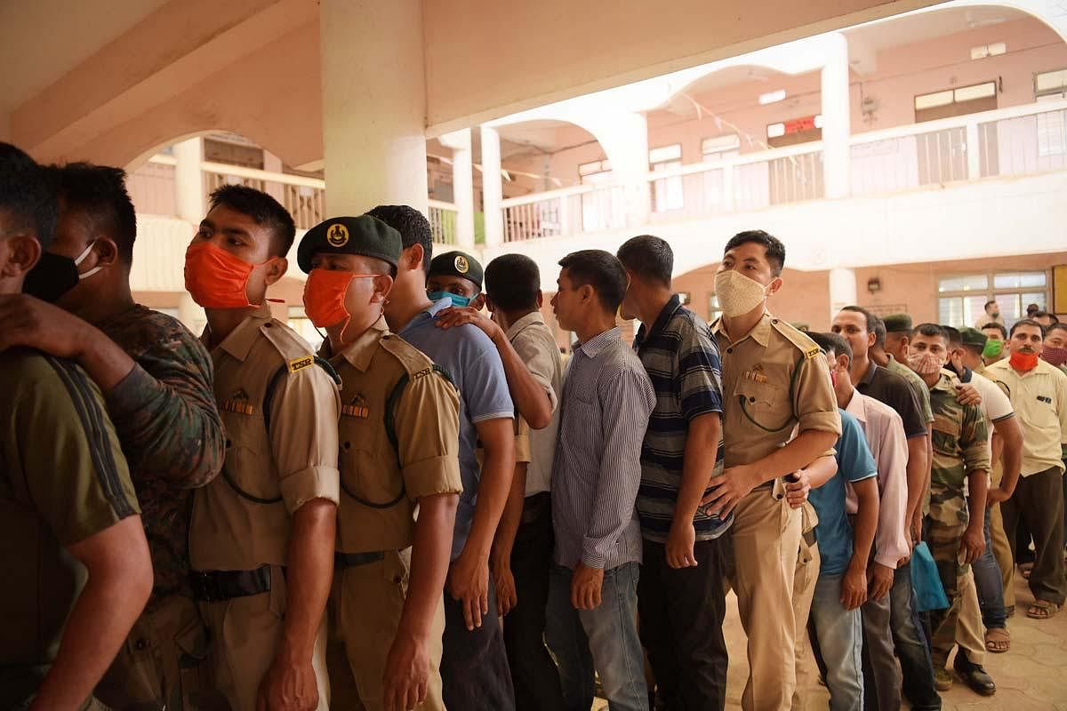 The security personal are seen in a polling station to cast their vote via postal ballot for government personnel, recruited for election duty. (Photo | Abhisek Saha)