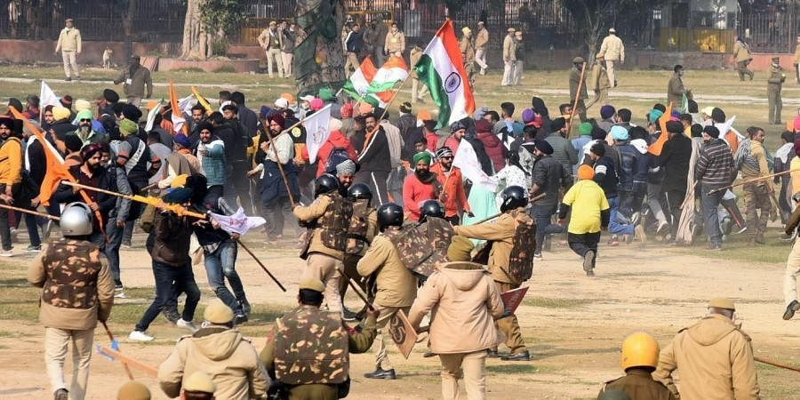 Police chase away protesters and farmers who had reached the Red Fort after the Republic Day parade in Delhi