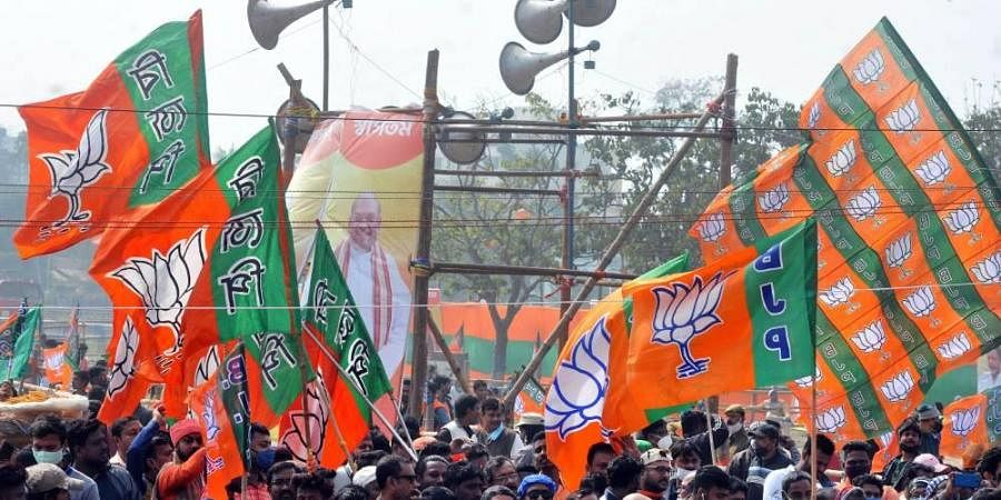 BJP workers gather during a public rally at Domurjala Stadium in Howrah district of West Bengal Sunday Jan. 31 2021.
