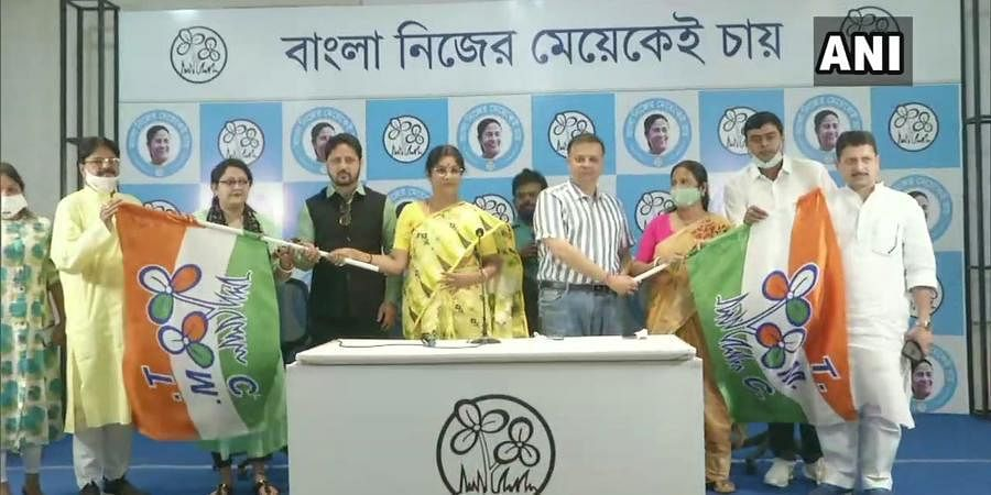 Film actor & director Dheeraj Pandit (fourth from left), actor Subhadra Mukherjee (third from left), & BJP leader Usha Chowdhury (third from right) join TMC in Kolkata.