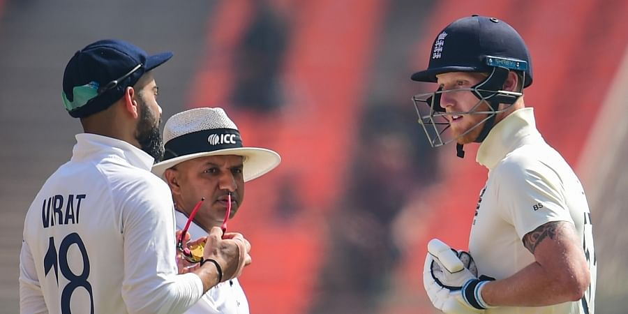 On-field umpire Nitin Menon intervenes as Indian skipper Virat Kohli and England all-rounder engage in an argument. (Photo | PTI)