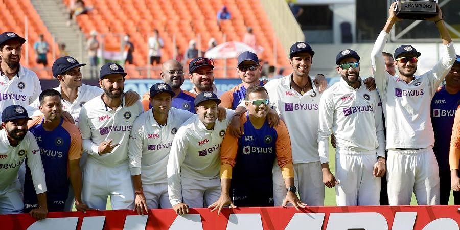 Indian cricket team players hold the torphy after defeating England in the 4th test match of the series at Narendra Modi Stadium in Ahmedabad, Saturday, March 6, 2021. (Photo   PTI)