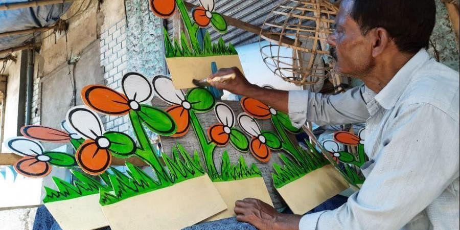 An artist makes party symbols with bamboos & paper at Dompara for an election campaign ahead of assembly elections, in Kolkata