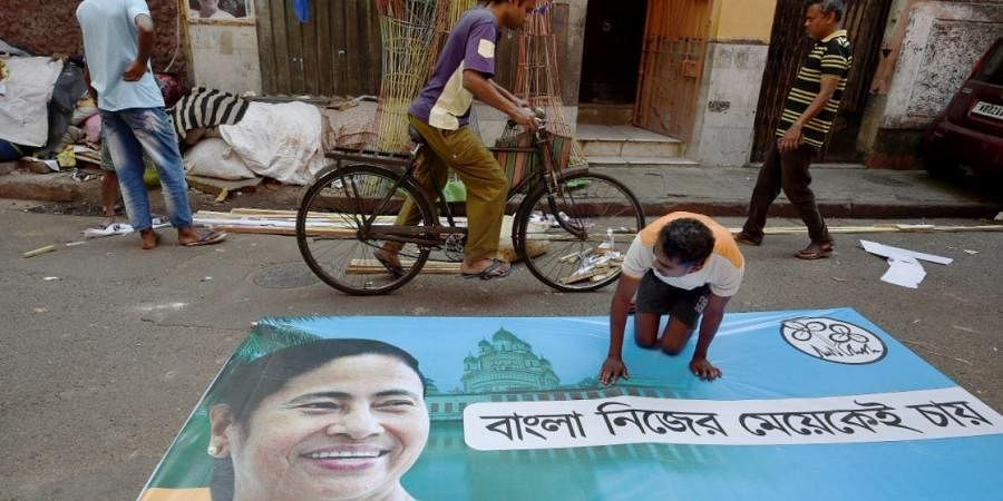 Workers busy in making a banner of Trinamool Congress chief Mamata Banerjee ahead of Assembly polls, in Kolkata