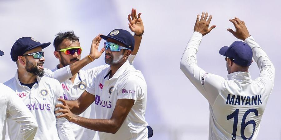 Indian players celebrate the dismissal of England batsman Ben Stokes.(Photo | PTI)