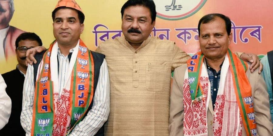 Rupesh Gowala (left) seen with Assam BJP president Ranjeet Kumar Dass and Paramananda Rajbongshi (right)