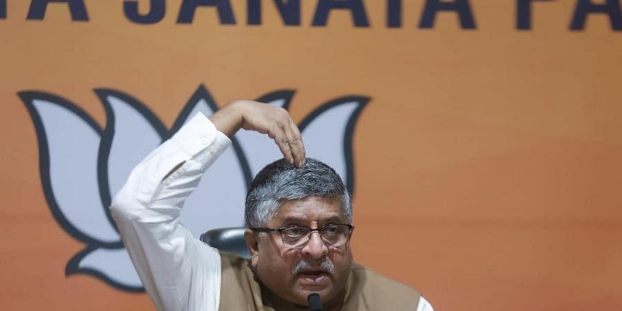 Senior BJP leader Ravi Shankar Prasad addresses a press conference at the party headquarters in New Delhi on Tuesday