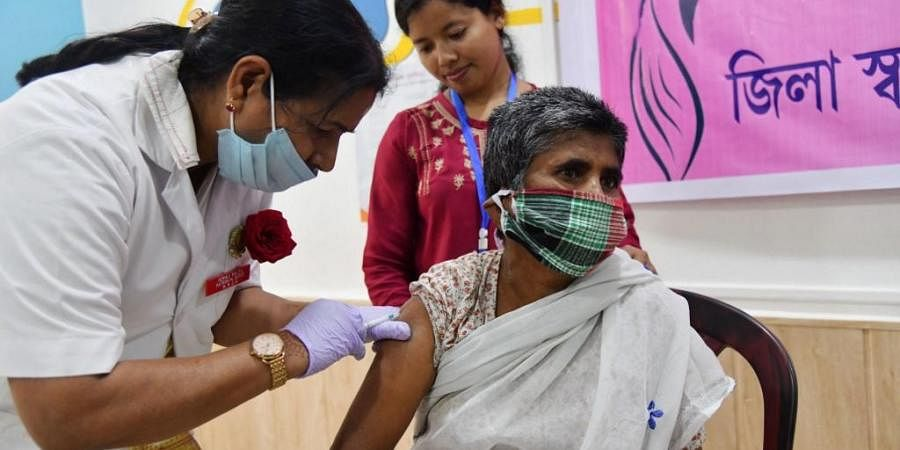 A health worker (L) inoculates a woman with a Covid-19 coronavirus vaccine at a government hospital. (Photo| AFP)