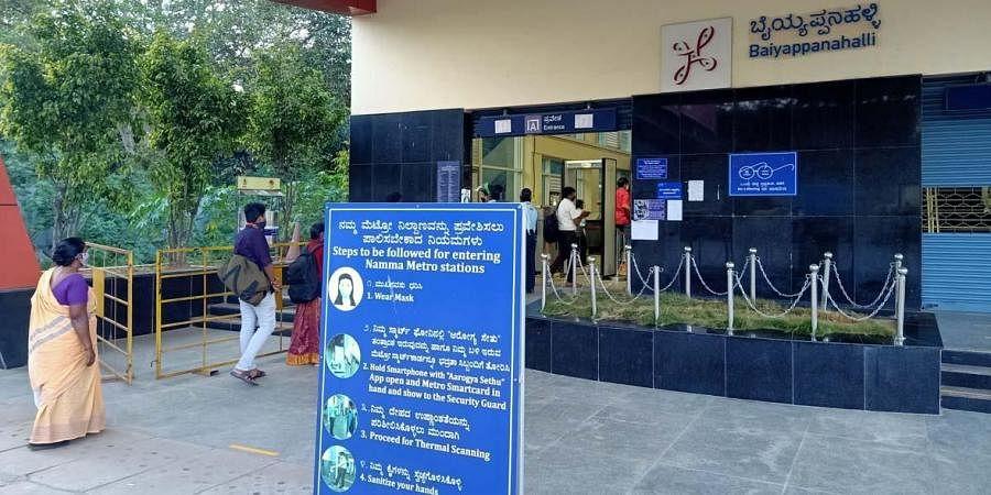 Board outside the Baiyappanahalli Metro Station displays Covid protocol. (Photo   Express)