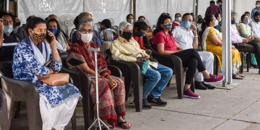 People wait for their turn to receive the COVID-19 vaccination at Max Hospital, Saket, in New Delhi