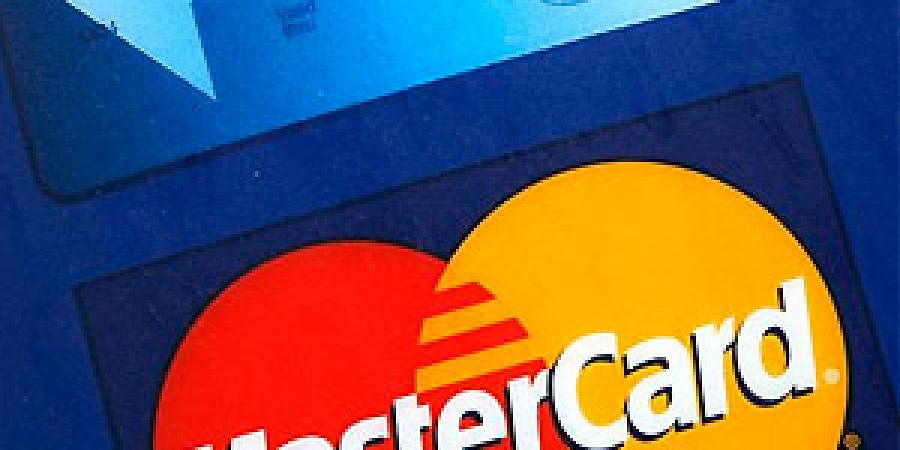 File photo of a sign for MasterCard credit cards is shown on the entrance to a bank, in New York.