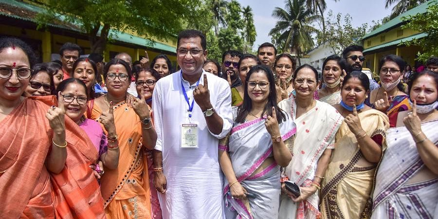 BJP Candidate Rupak Sarmah shows his finger marked with indelible ink after casting his vote at a polling station during the second phase of Assam Assembly Polls, in Nagaon