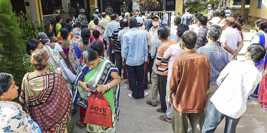 Voters queue up to cast their votes during the second phase of West Bengal Assembly polls, at a polling station in Bankura on Thursday.