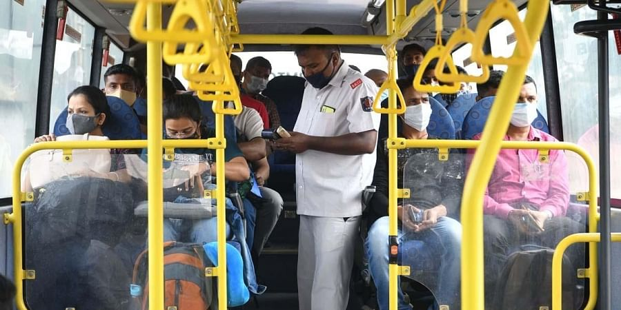 An airport bus jam-packed with passengers on Wednesday   Meghana Sastry
