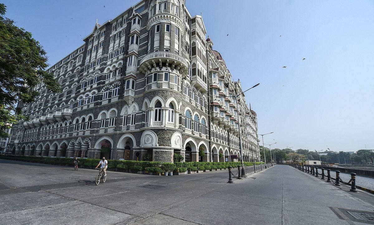 A deserted view of Mumbai's Taj Hotel Gateway as Maharashtra Government announced a weekend lockdown due to a surge in COVID-19 cases. (Photo | PTI)