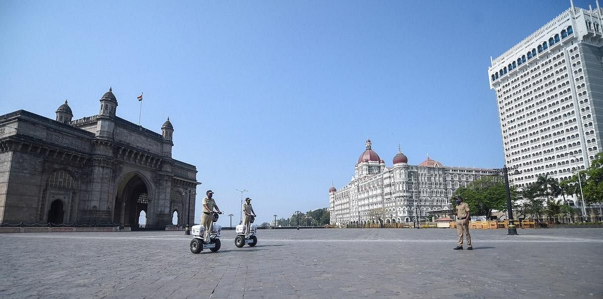 Empty streets, complete compliance: No people at the scene near Gateway of India after the state government orders for total lockdowns during the weekends. (Photo | PTI)