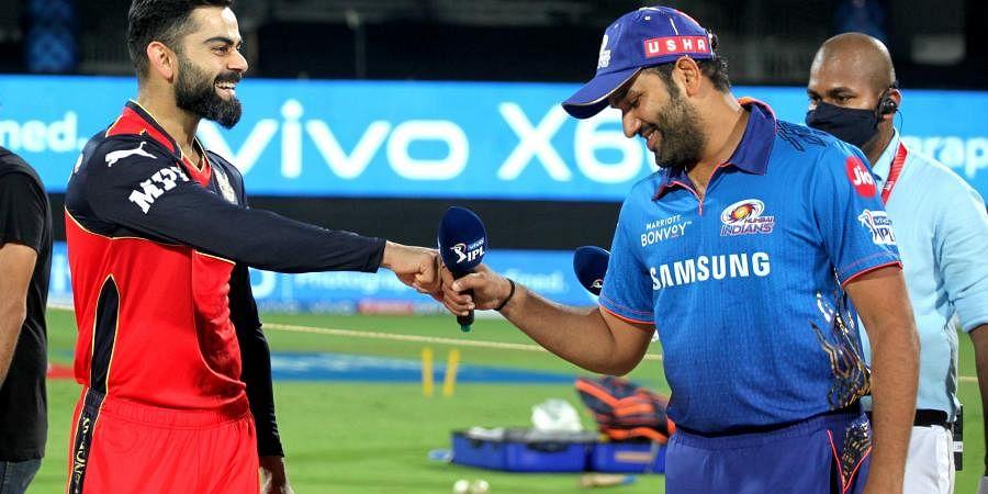Virat Kohli, captain of Royal Challengers Bangalore, and Rohit Sharma, captain of Mumbai Indians. (Photo   PTI)