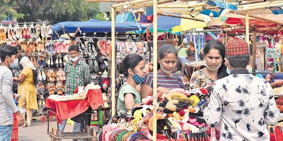 A group of women purchase goods from a bazar without properly wearing their masks, in Hyderabad on Friday | Vinay Madapu
