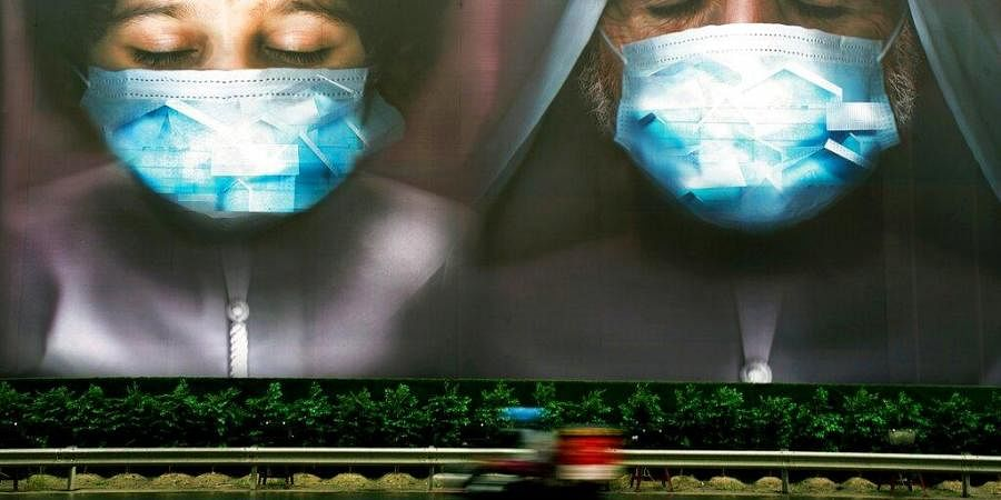 a billboard urges people to stay home during the coronavirus pandemic in Dubai