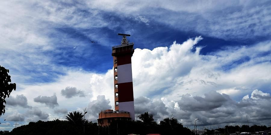Marina Lighthouse is surrounded by thick clouds.