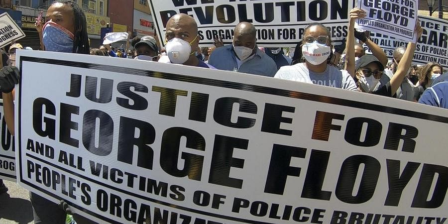 A rally and march by the People's Organization Progress is held to protest the death of George Floyd.
