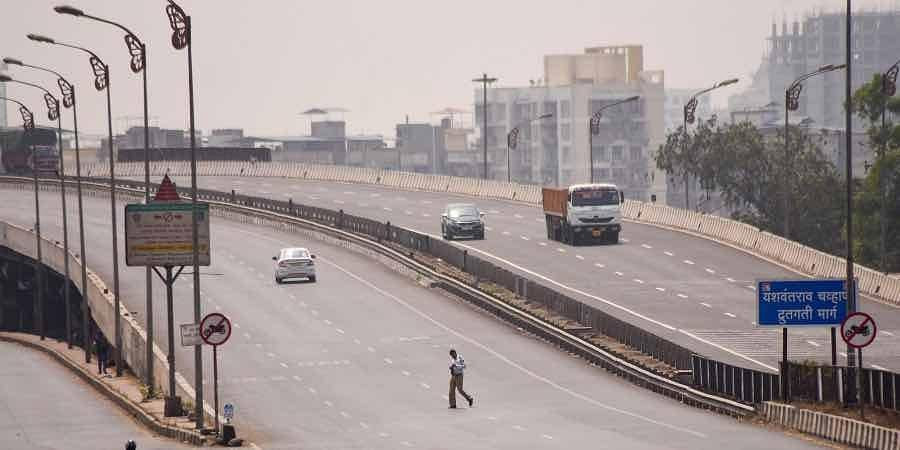 Mumbai-Pune Expressway wears a deserted look during weekend lockdown imposed by Maharashtra Government to curb spread of Coronavirus in Navi Mumbai