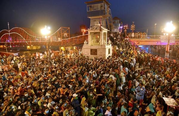 Covid protocols drown as 13 lakh devotees take dip on third day of Maha Kumbh