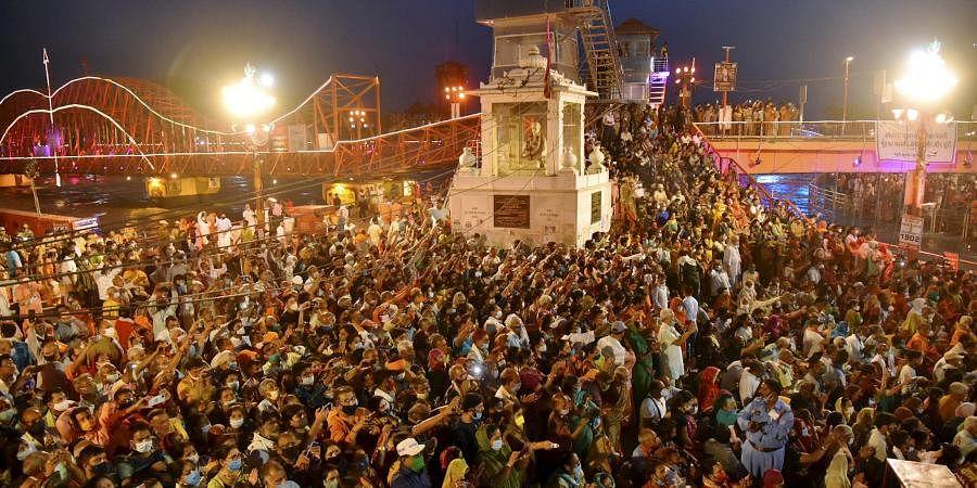 Devotees gather to offer prayers during Ganga aarti at Kumbh Mela, at Har ki Pouri, in Haridwar,