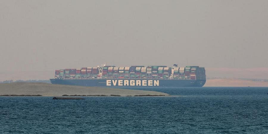 MV Ever Given, a Panama-flagged cargo ship, is seen in Egypt's Great Bitter Lake