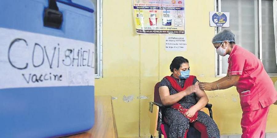 A health worker administers a Covid vaccine to a woman at KC General Hospital in Bengaluru on Sunday | shriram bn