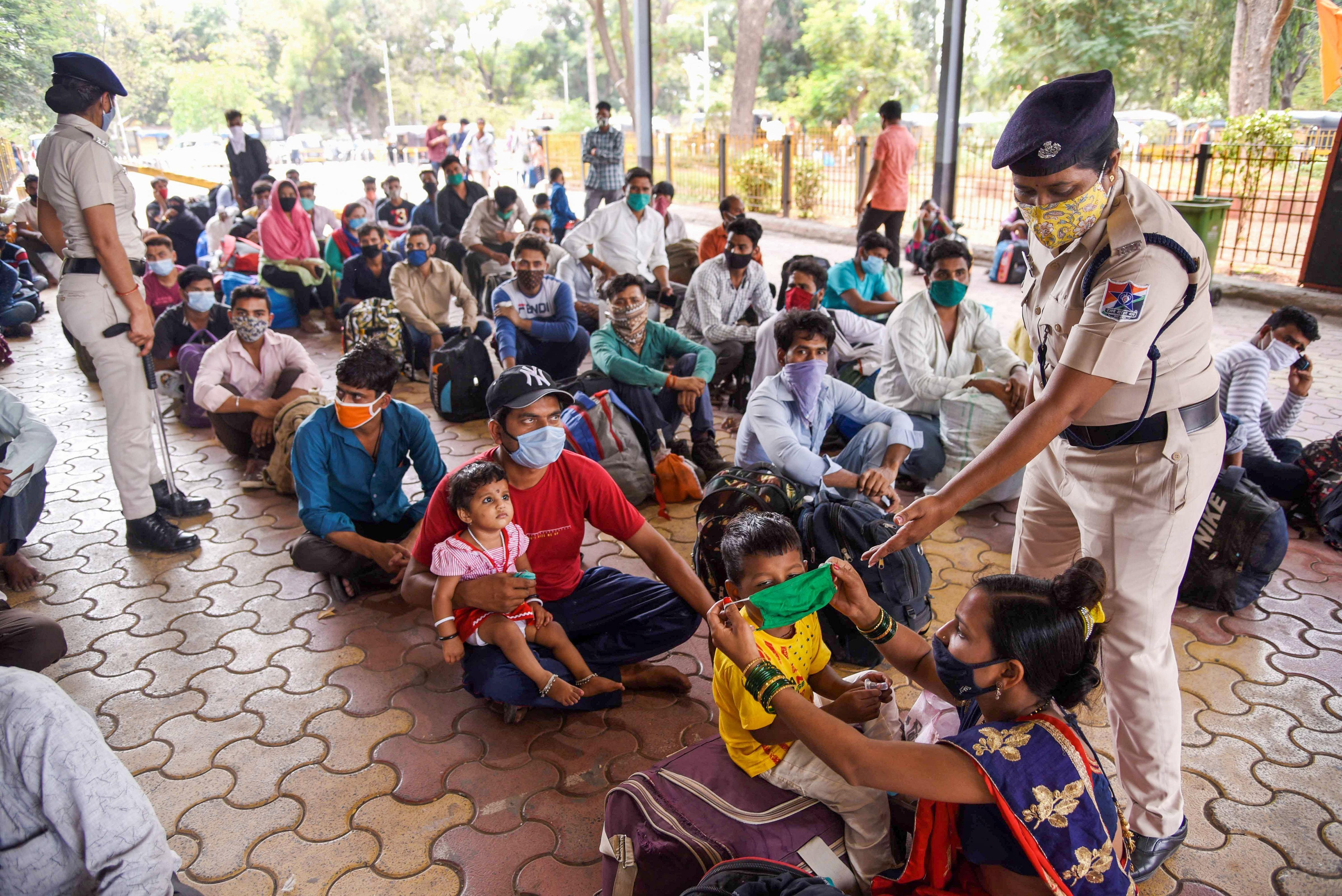 Migrant workers wait at Panvel Railway Station to board a train for Gorakhpur in Uttar Pradesh, after surge in coronavirus cases, in Navi Mumbai