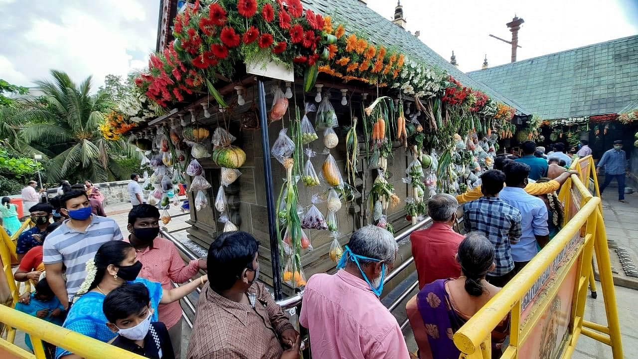 Devotees gather at a temple to offer prayers on the occasion of the 'Vishu Festival', in Chennai