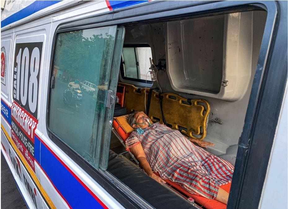 A COVID-19 patient receives primary treatment inside an ambulance at the COVID-19 OPD of the Government Civil Hospital, in Ahmedabad