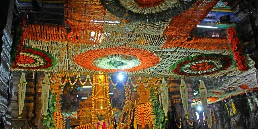 The temple flag marking the beginning of Chithirai Festival is being hoisted by the priests at the Meenakshi Sundareswarar temple.