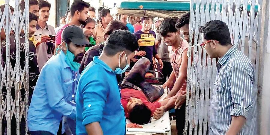 A man injured in clashes during the fourth phase of Bengal elections  in Cooch Behar is brought to a hospital on Saturday. (Photo | PTI)