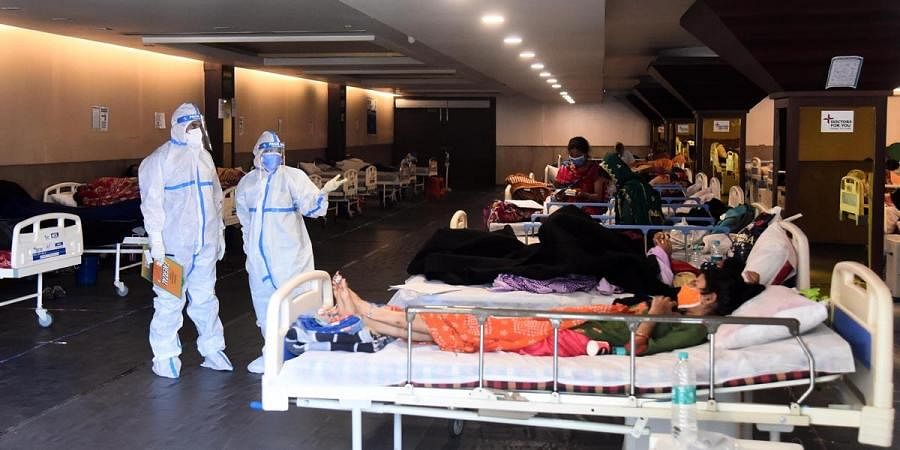 Patients are seen inside a Covid-19 care centre and isolation ward facility near a hospital in New Delhi, April 13, 2021 | Parveen Negi